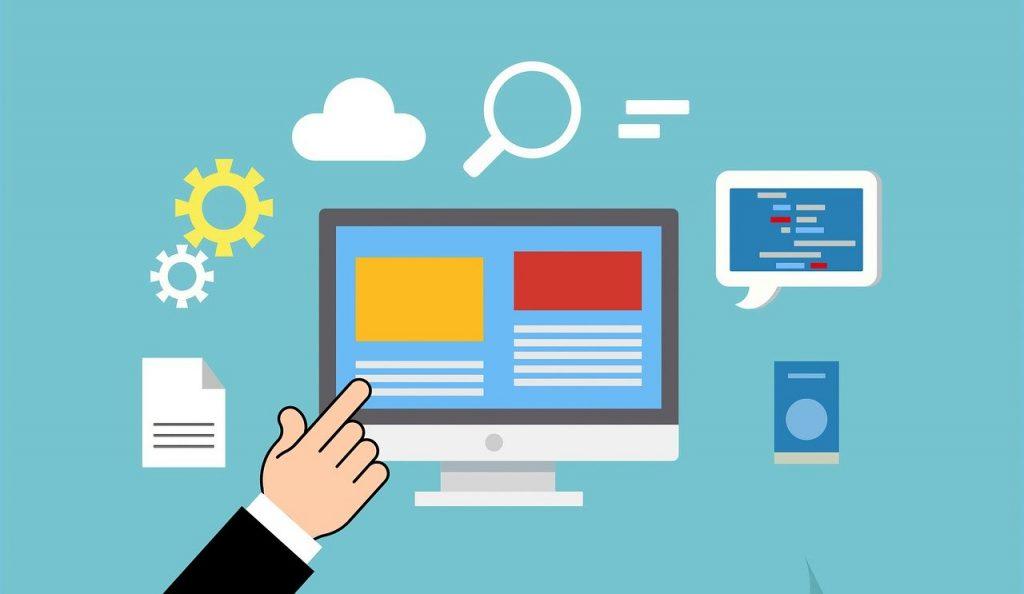 main qui pointe vers un ordinateur et tous les services qu'il peut offrir